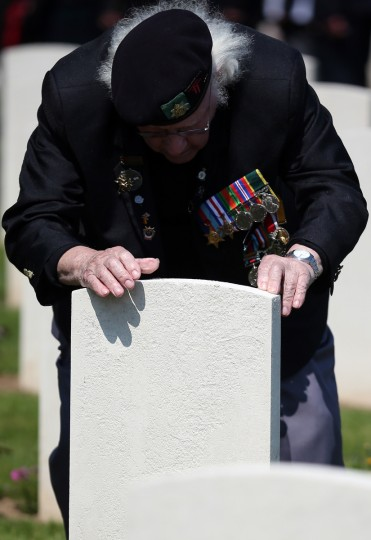 Normandy Veteran Reg Burge looks at the headstone of a fallen comrade at a remembrance and wreath laying ceremony to commemorate the start of the D-Day landings at Bayeux War Cemetery in Bayeux, France. (Matt Cardy/Getty Images)