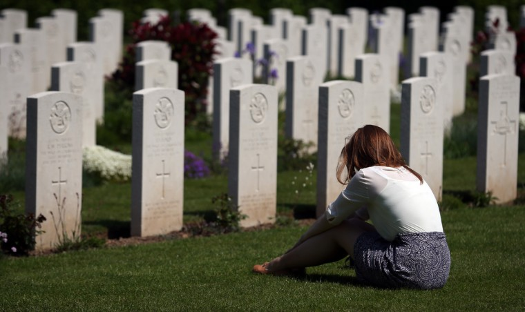 A visitor to Bayeux War Cemetery looks at the headstones for British servicemen that were killed during the Normandy campaign at a remembrance and wreath laying ceremony to commemorate the start of the D-Day landings in Bayeux, France. (Matt Cardy/Getty Images)