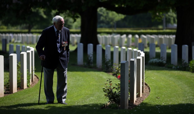 Normandy Veteran 90-year-old Eric Gibbons looks at the headstones of fallen comrades at a remembrance and wreath laying ceremony to commemorate the start of the D-Day landings at Bayeux War Cemetery in Bayeux, France. (Matt Cardy/Getty Images)