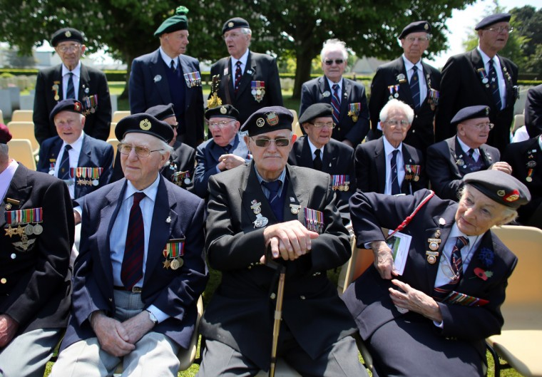Normandy Veterans, attend a remembrance and wreath laying ceremony to commemorate the start of the D-Day landings at Bayeux War Cemetery. (Matt Cardy/Getty Images)