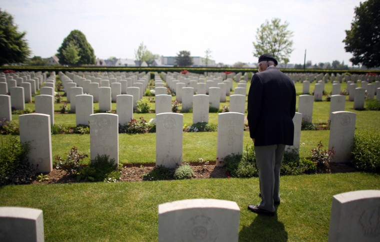 Normandy Veteran 90-year-old Bob Barker looks at the headstones of fallen comrades at a remembrance and wreath laying ceremony to commemorate the start of the D-Day landings at Bayeux War Cemetery. (Matt Cardy/Getty Images)