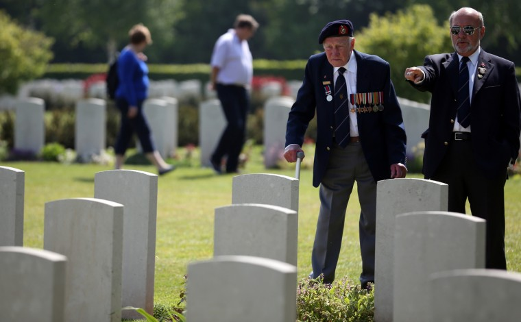 A Normandy Veteran looks at the headstones of fallen comrades at a remembrance and wreath laying ceremony to commemorate the start of the D-Day landings at Bayeux War Cemetery in Bayeux, France. (Matt Cardy/Getty Images)