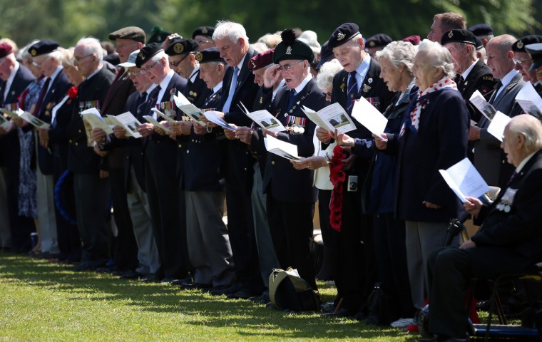 Normandy Veterans attend a remembrance and wreath laying ceremony to commemorate the start of the D-Day landings at Bayeux War Cemetery. (Matt Cardy/Getty Images)