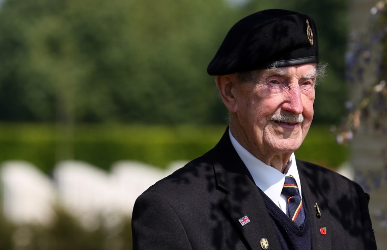 A Normandy Veteran, stands in the shade at a remembrance and wreath laying ceremony to commemorate the start of the D-Day landings at Bayeux War Cemetery in Bayeux, France. (Matt Cardy/Getty Images)