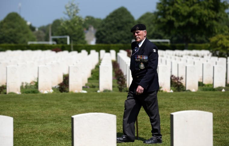 Normandy Veteran, Major Edwin Hunt, looks at the headstones of fallen comrades at a remembrance and wreath laying ceremony to commemorate the start of the D-Day landings at Bayeux War Cemetery. (Matt Cardy/Getty Images)
