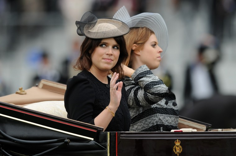 Princess Eugenie (L) and Princess Beatrice attend day one of Royal Ascot at Ascot Racecourse on June 18, 2013 in Ascot, England. (Charlie Crowhurst/Getty Images)