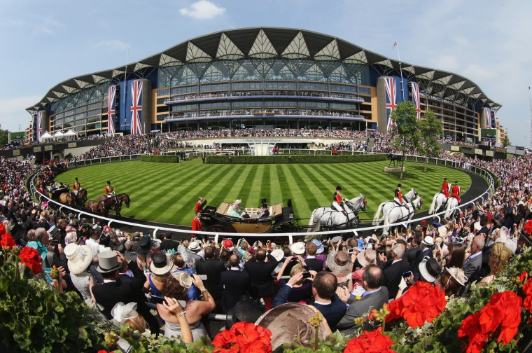 The Royal Procession passes around the Parade Ring in front of the Main Grandstand on day two of Royal Ascot at Ascot Racecourse on June 19, 2013 in Ascot, England. (Chris Jackson/Getty Images )