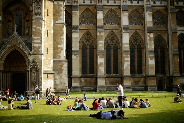 Members of the public enjoy the hot weather outside Westminster Abbey in London, England. Whilst the country is currently experiencing high temperatures, there has been a prediction by senior meteorologists that Britain may be expecting up to 10 years of rainy summers due to warming of the North Atlantic waters. (Matthew Lloyd/Getty Images)