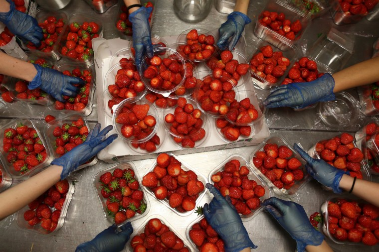 Strawberries are prepared during day two of the Wimbledon Lawn Tennis Championships at the All England Lawn Tennis and Croquet Club in London, England. (Dan Kitwood/Getty Images)