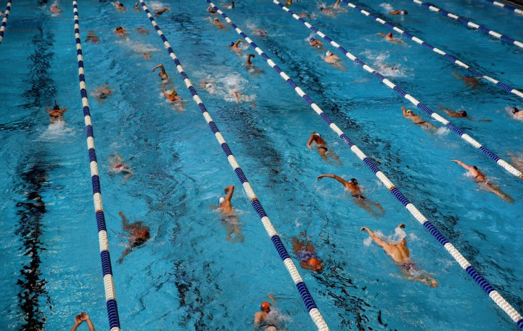 A general view of competitors warming up ahead of day 1 of the 2013 USA Swimming Phillips 66 National Championships and World Trials at the Indiana University Natatorium in Indianapolis, Indiana. (Streeter Lecka/Getty Images)