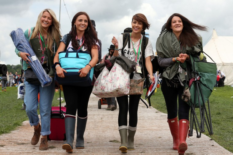 (L-R) Tash Sullivan, Jessica Shakles, Zoe Audibert and Rose Long arrive at the Glastonbury Festival of Contemporary Performing Arts site at Worthy Farm, in Pilton at Worthy Farm, Pilton on June 26, 2013 near Glastonbury, England. (Matt Cardy/Getty Images)