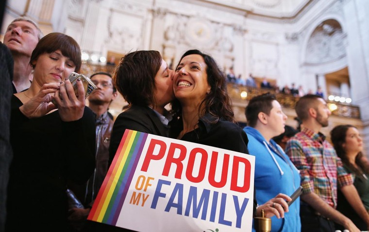 A couple celebrates upon hearing the U.S. Supreme Court's rulings on gay marriage in City Hall June 26, 2013 in San Francisco, United States. The high court struck down DOMA, and will rule on California's Prop 8 as well. (Justin Sullivan/Getty Images)