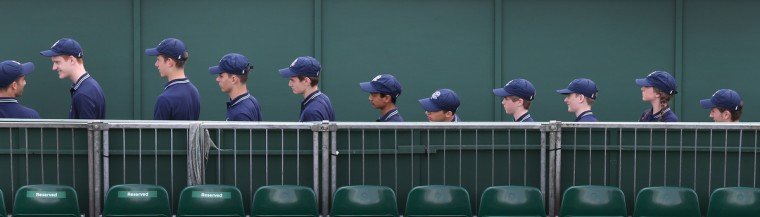 Ball boys and ball girls line up to enter a court on day four of the Wimbledon Lawn Tennis Championships at the All England Lawn Tennis and Croquet Club in London, England. (Peter Macdiarmid/Getty Images)