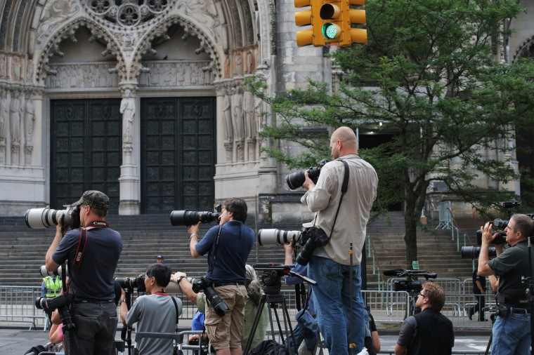 Members of the media photograph attendees arriving at actor James Gandolfini's funeral at The Cathedral Church of St. John the Divine on June 27, 2013 in New York City. Gandolfini passed away on June 19, 2013 while vacationing in Rome, Italy. (Andrew Burton/Getty Images)