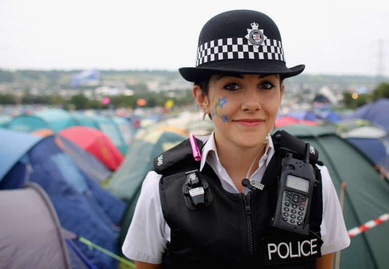 Special constable Sandie Davies, poses for a photograph at the Glastonbury Festival site at Worthy Farm, Pilton on June 27, 2013 near Glastonbury, England. Asked what the Glastonbury Festival meant to her, the 20-year-old from said,'Meeting new people and a great chance to engage with the community'. (Matt Cardy/Getty Images)
