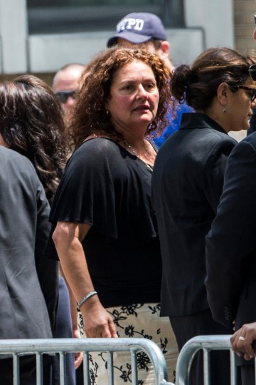 Actor Aida Turturro leaves after attending the funeral for Actor James Gandolfini at The Cathedral Church of St. John the Divine on June 27, 2013 in New York City. (Andrew Burton/Getty Images)