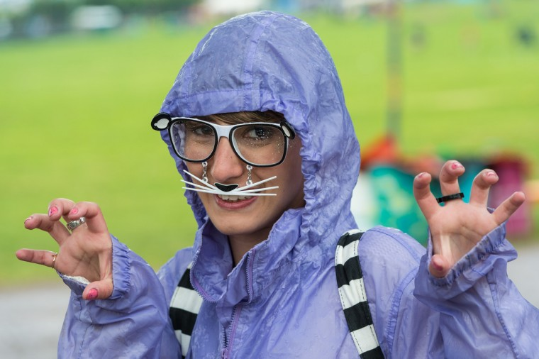 A festival goer enjoys the atmosphere as rain falls during day 1 of the 2013 Glastonbury Festival at Worthy Farm on June 27, 2013 in Glastonbury, England. (Ian Gavan/Getty Images)
