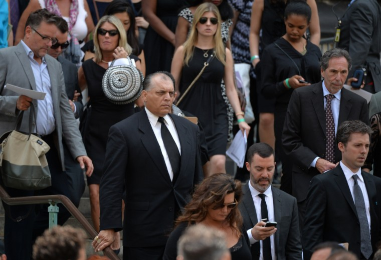 "Mourners depart the Cathedral Church of St. John the Divine after the funeral service for ""Sopranos"" actor James Gandolfini on June 27, 2013 in New York. (Stan Honda/Getty Images)"