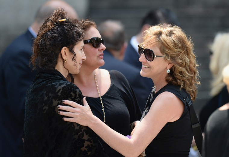 Actors Aida Turturro (2nd from L) and Edie Falco attend the funeral for actor James Gandolfini at The Cathedral Church of St. John the Divine on June 27, 2013 in New York City. Gandolfini passed away on June 19, 2013 while vacationing in Rome, Italy. (Mike Coppola/Getty Images)