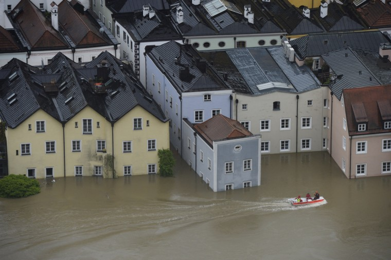 Rescue workers pass on a boat the overflooded old city of Passau, southern Germany, on June 3, 2013. Due to heavy and ongoing rainfalls, parts of the southern state of Bavaria were flooded. (Christof Stache/Getty Images)