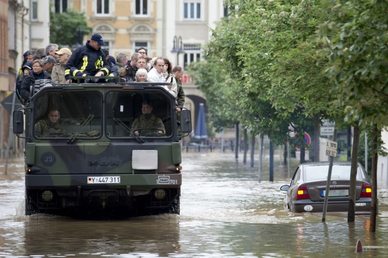 Residents of flooded areas in Gera, eastern Germany are evacuated on June 3, 2013. Parts of the eastern and southern Germany were flooded due to heavy and ongoing rainfalls.(Marc Tirl/Getty Images)