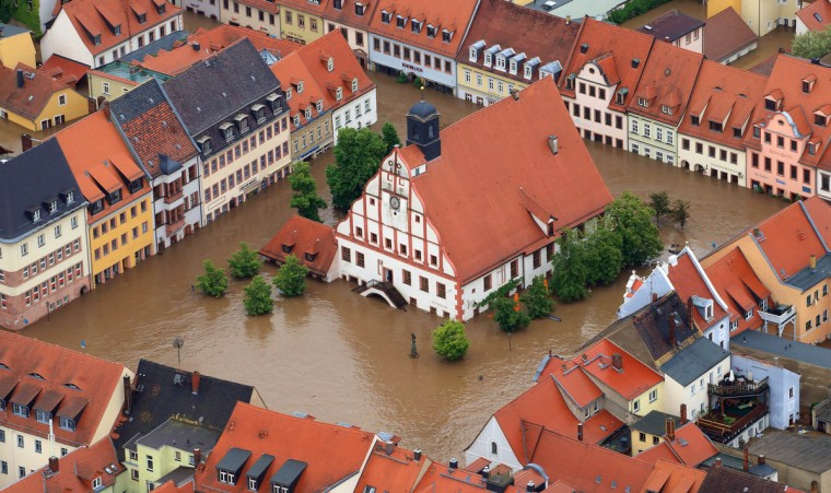 An aerial view shows the flooded city centre of Grimma, eastern Germany, on June 3, 2013. Parts of the eastern and southern Germany were flooded due to heavy and ongoing rainfall. (Jens Wolf/Getty Images)