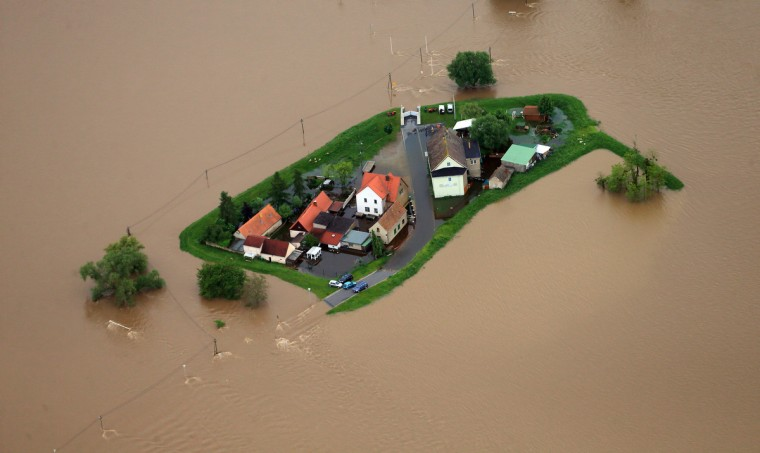 Floodwater of the river Mulde encloses some houses north of Eilenburg, eastern Germany, on June 3, 2013. Parts of the eastern and southern Germany were flooded due to heavy and ongoing rainfalls. (Jens Wolf/Getty Images)