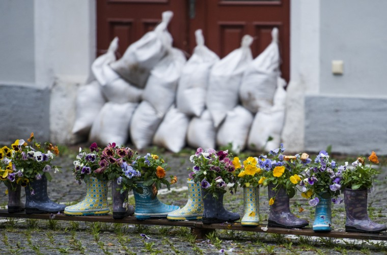 Rubber boots filled with flowers stand in front of the entrance of a house protected with sand bags against the floods of the river Elbe on June 4, 2013 in Meissen, eastern Germany. Torrential rain and heavy flooding hit central Europe. (Martin Foerster/Getty Images)