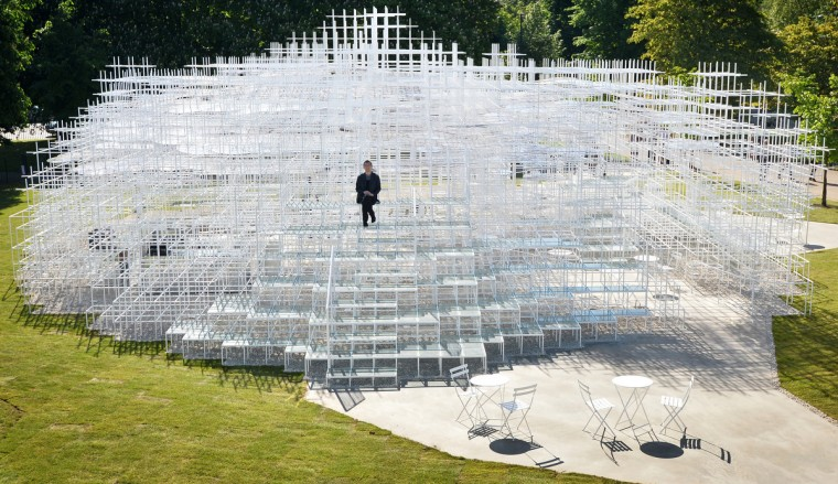 Japanese architect Sou Fujimoto poses for photographers with his Serpentine Gallery Pavilion structure at the Serpentine Gallery in London. The Serpentine Gallery Pavilion 2013, designed by Japanese architect Sou Fujimoto will open on 8 June . Fujimoto is the thirteenth and, at 41, youngest architect to accept the invitation to design a temporary structure for the Serpentine Gallery. (Ben Stansall/Getty Images)
