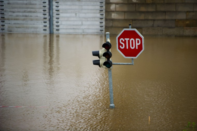 A traffic light and a sign stand on a flooded street in Dresden, eastern Germany, on June 4, 2013.Torrential rain and heavy flooding hit central Europe. (Arno Burgi/Getty Images)