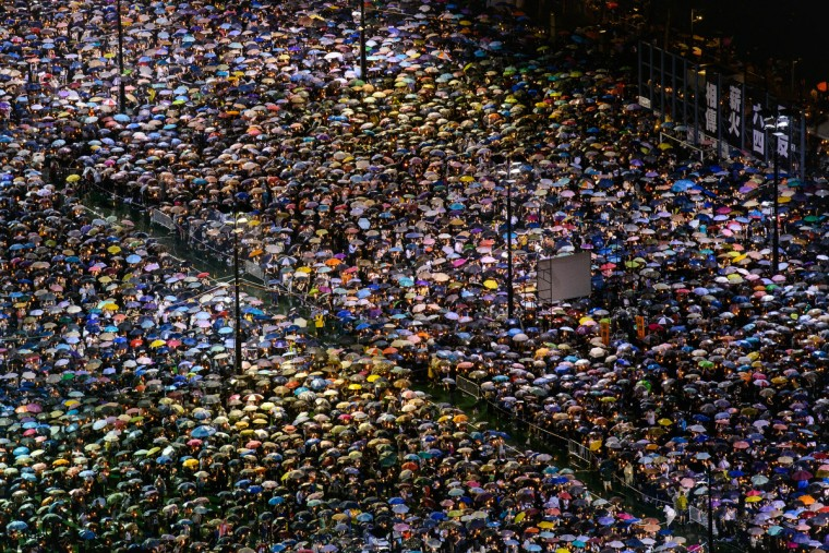People are seen gathered at Victoria Park during a candlelight vigil held to mark the 24th anniversary of the 1989 crackdown at Tiananmen Square, in Hong Kong. More than 100,000 people were expected to attend the candlelight vigil in the former British colony which is the only place in China where the brutal military intervention that ended weeks of nationwide democracy protests in 1989 is openly commemorated. (Philippe Lopez/Getty Images)