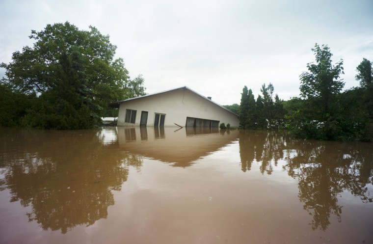 A house is flooded by the river Vltava in Kly, near Melnik, Czech Republic, on June 4, 2013. Torrential rain and heavy flooding hit central Europe. (Michal Cizek/Getty Images)