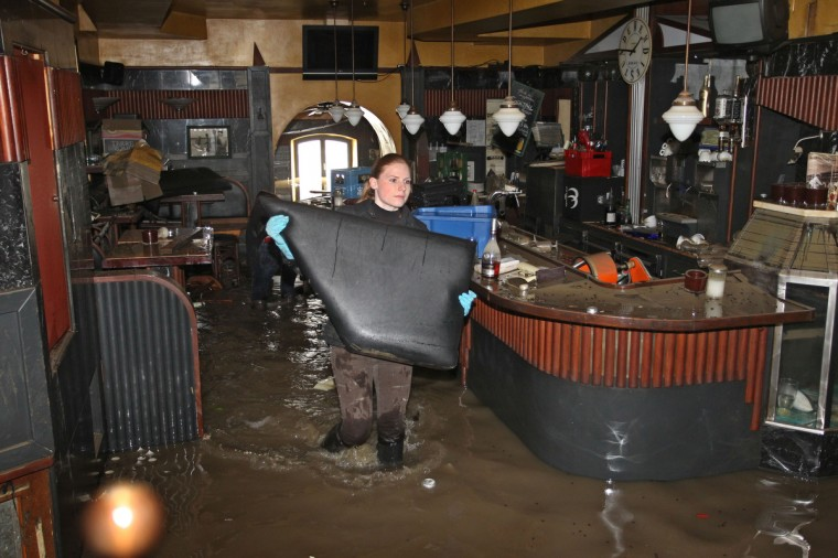 Helpers clean a flooded bar in the inner city of Passau in Germany, on June 4, 2013. Flooding situation in Bavaria is serious. (Karl-Josef Hildenbrand/Getty Images)