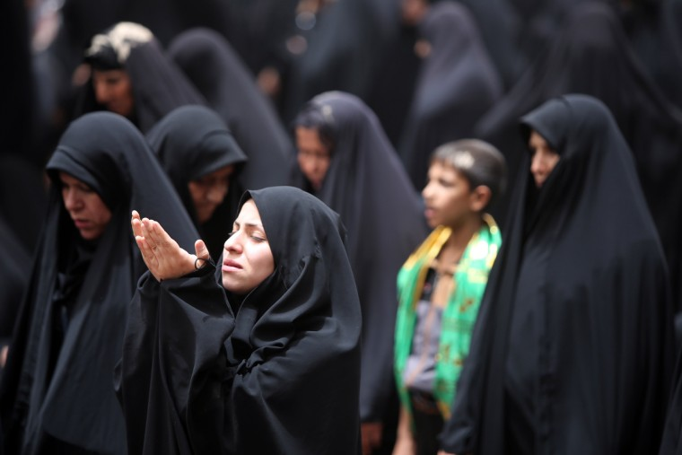 Iraqi Shiite Muslim women pray at the shrine of Imam Moussa al-Kadhim, to mark the anniversary of the death of the religious figure, in the northern district of Kadhimiya in the Iraqi capital Baghdad. Pilgrims are converging on the Imam's shrine to mark the death of the seventh Imam, who was imprisoned for four years and then poisoned by the then ruler Harun al-Rashid in 795. (Ahmad Al-Rubaye/Getty Images)