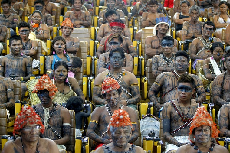 Mundurukus natives opposed to the construction of the controversial Belo Monte dam in the state of Para are received by Brazil's Secretary General of the Presidency, Gilberto Carvalho, at the Planalto Palace. Five indigenous tribes are calling for legislation under which they would have to be consulted prior to any official decision affecting them with respect to the dam's construction. Belo Monte, which is being built at a cost of $13 billion, is expected to flood an area of 500 square km along the Xingu River, displacing 16,000 people, according to the government. Some NGOs have estimated that some 40,000 people would be displaced by the massive project. Indigenous groups say the dam will harm their way of life while environmentalists warn of deforestation, greenhouse gas emissions and irreparable damage to the ecosystem. (Beto Barata/Getty Images)