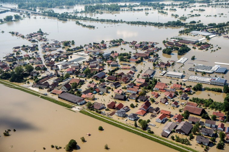 Aerial view shows flooding in Deggendorf, southern Germany on June 5, 2013. Cities in Germany and the Czech Republic were scrambling to stave off potential disaster as a flood wave headed north, sending thousands of people fleeing their homes. (Armin Weigel/Getty Images)