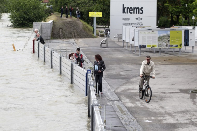 People are seen at the flood walls on June 5, 2013 in Krems an der Donau. Water levels of the flooded Danube reached their highest point in the Austrian capital where the port and riverside restaurants had already succumbed to the deluge. (Dieter Nagl/Getty Images)