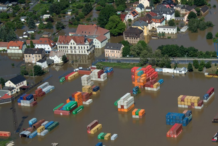 Aerial view shows a flooded container storage facility in Riesa, eastern Germany, on June 5, 2013. German, Czech and Austrian river cities braced for rising flood waters, evacuating thousands and boosting defences along the swollen Elbe and Danube, after inundations from heavy rains left 11 people dead. (Johannes Eisele/Getty Images)