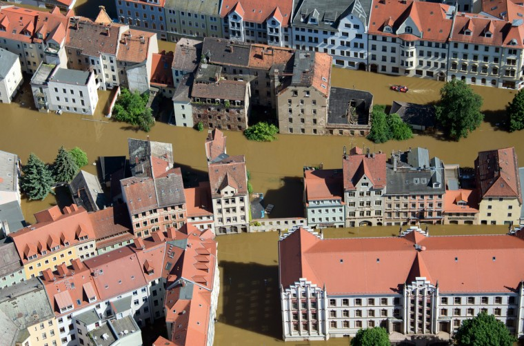 Aerial view shows the flooded city of Meissen, eastern Germany, on June 5, 2013. German, Czech and Austrian river cities braced for rising flood waters, evacuating thousands and boosting defences along the swollen Elbe and Danube, after inundations from heavy rains left 11 people dead. (Johannes Eisele/Getty Images)