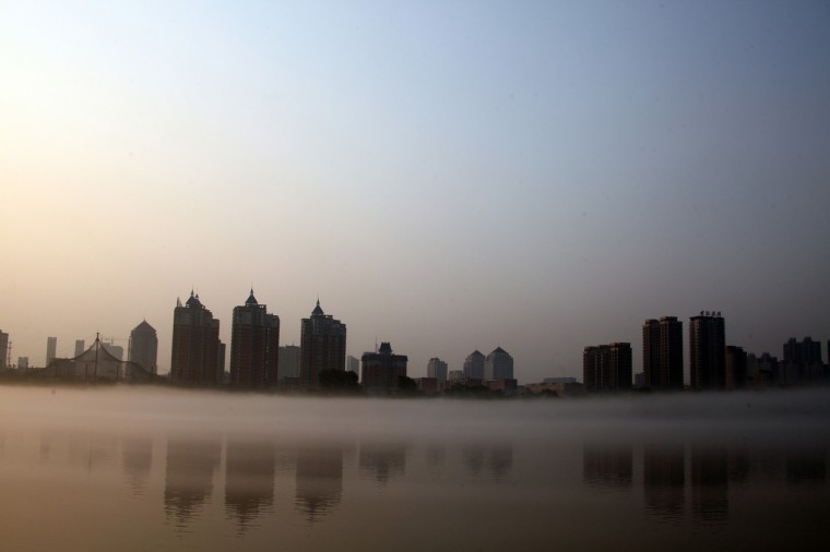 A light fog is seen over Songhuajiang River in Jilin, northeast China's Jiling province, in the morning. Songhuajiang River is the largest tributary of the Heilong River, flowing about 1,434 kilometres (891 miles) from Changbai Mountains through Jilin and Heilongjiang provinces. (Stringer/Getty Images)