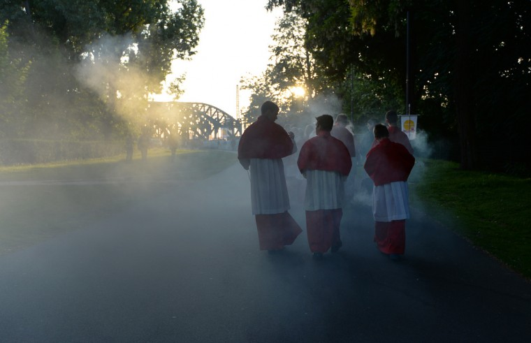 Catholic altar servers swing incense burners as they cross the Hohenzollernbruecke bridge towards the Cologne cathedral during a procession of an Eucharistical Congress in Cologne, western Germany. (Patrik Stollar/Getty images)