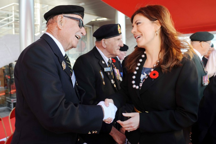 Canadian Junior Minister for Veterans Eve Adams (R) greets a Canadian World War II veteran as she takes part in a ceremony at the Juno Beach centre in Courseulles-sur-Mer. (Thomas Bregardis/Getty Images)
