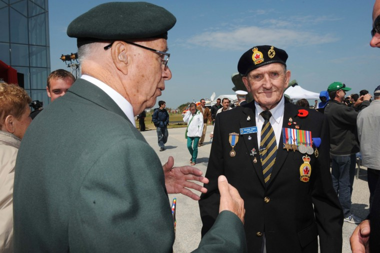 Canadian World War II veterans discuss during a ceremony at the Juno Beach centre in Courseulles-sur-Mer during the commemoration of the 69th anniversary of the D-Day landing in Normandy. (Thomas Bregardis/Getty Images)