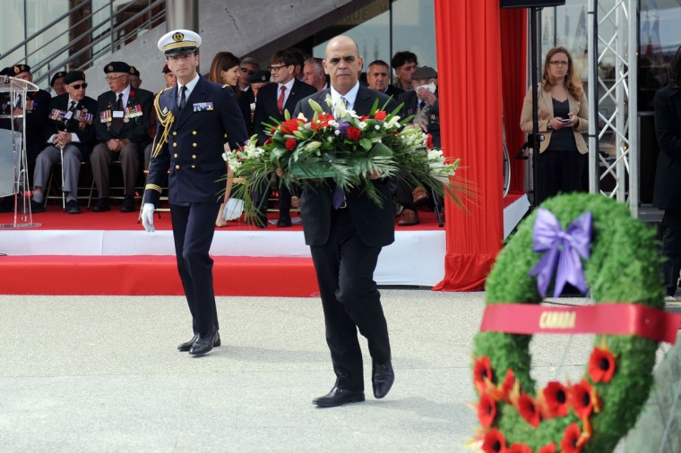 French Junior Minister for Veterans Kader Arif (C) lays a wreath in honour of Canadian World War II soldiers as he takes part in a ceremony at the Juno Beach centre in Courseulles-sur-Mer. (Thomas Bregardis/Getty Images)