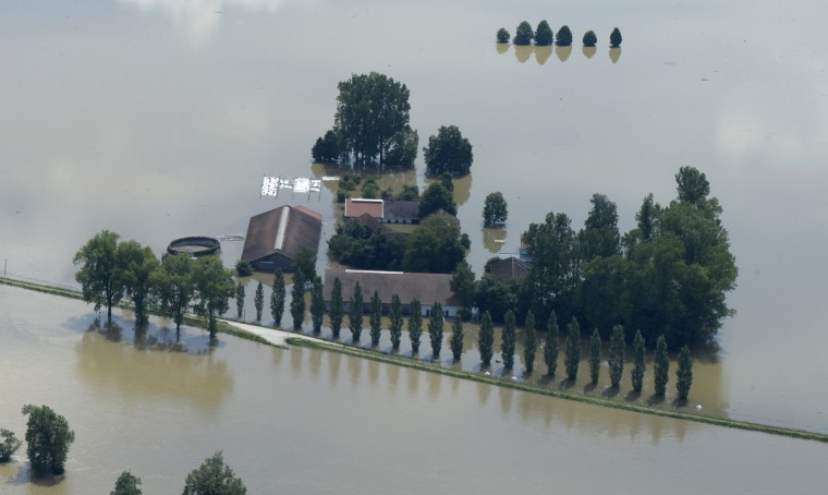 An aerial view shows houses flooded by water from the River Danube near the Bavarian village Deggendorf, southern Germany. (Christof Stachea/Getty Images)