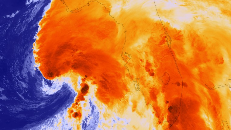 This National Oceanic and Atmospheric Administration (NOAA) image released June 6, 2013 shows Tropical Storm Andrea as it intensified over night, as the Suomi NPP satellite passed over the storm, taking this highly detailed infrared imagery showing the overshooting cloud tops (colored dark orange) associated with the most intense areas of convection - and threat for tornadoes. Tropical storm Andrea churned toward Florida Thursday with the threat of heavy rains and tornadoes, after damaging crops in Cuba and forcing the evacuation of some 2,600 people. As of midday the first named storm of the Atlantic season packed maximum winds of 95 km per hour (60 mph) as it moved northeast at 22 kilometers per hour (14 mph). It was 255 kilometers (160 miles) west of Tampa and expected to pick up speed over the course of the day, the National Hurricane Center in Miami said, adding that Andrea carried the potential for whipping up tornadoes in central and southern Florida. (NOAA)
