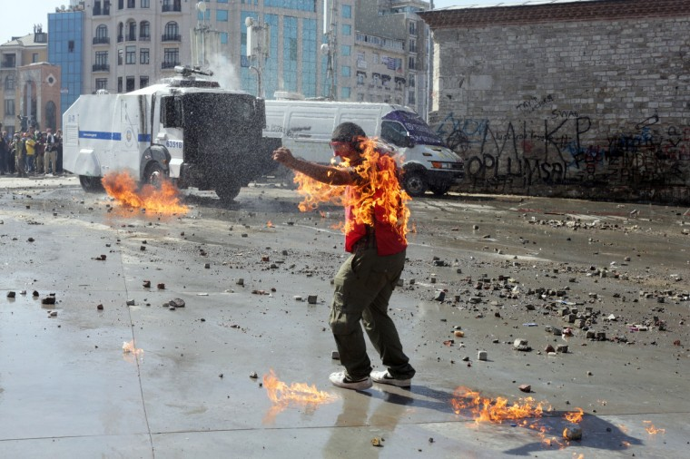 A demonstrator's clothes are set on fire during clashes with riot police in Taksim square. Riot police stormed Istanbul's protest square, firing tear gas and rubber bullets at firework-hurling demonstrators in a fresh escalation of unrest after Turkish Prime Minister Recep Tayyip Erdogan said he would meet with protest leaders. (Oren Ziv/Getty Images)