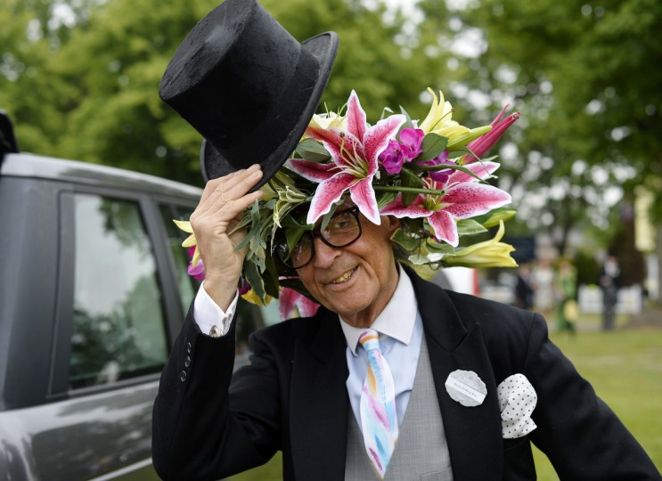 Milliner David Shilling doffs his hat during the first day of Royal Ascot, in Berkshire, west of London. (Adrian Dennis/Getty Images)