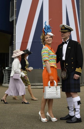 Award winning Milliner Mimi Theobold (2-R) and her husband Doug pose for a photograph during the first day of Royal Ascot, in Berkshire, west of London. (Adrian Dennis/Getty Images)