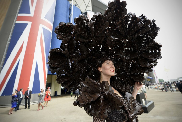 Larisa Katz, wearing an outfit made from chocolate packaging, poses for a photograph during the second day of Royal Ascot, in Berkshire, west of London. (Adrian Dennis/Getty images)